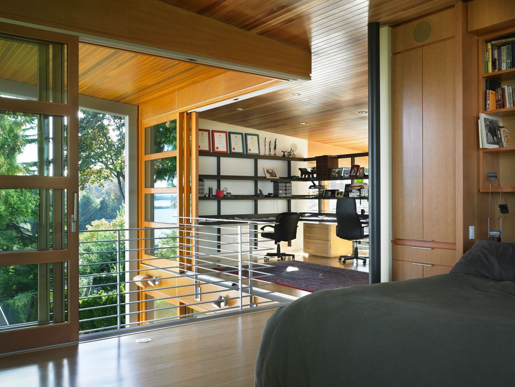 modern home office with natural light wood panel ceiling hardwood floors built natural lighting home office