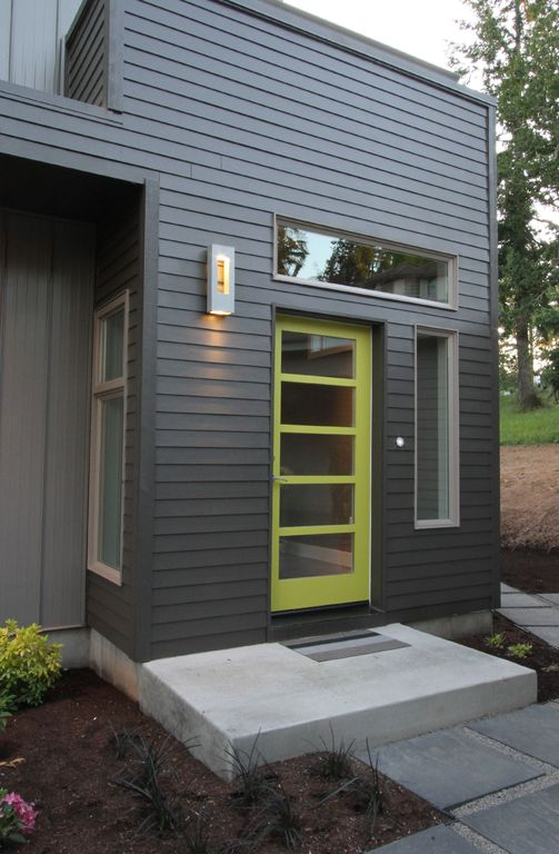 Modern Front Door With Exterior Stone Floors By Jordan Iverson Zillow Digs