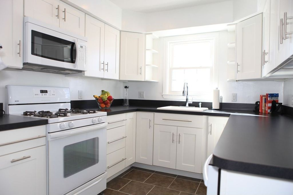 Traditional Kitchen with Anthracite Solid Surface Countertop, Corian ...