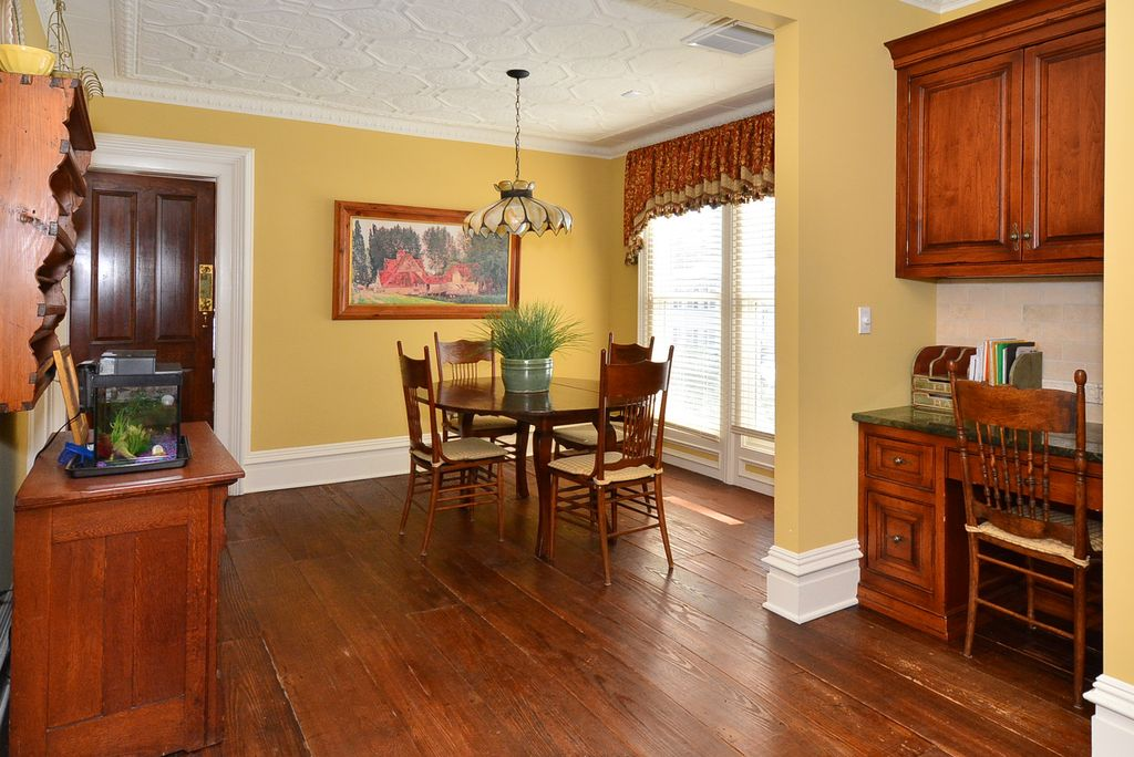 country dining room with pendant light hardwood floors in ridgewood