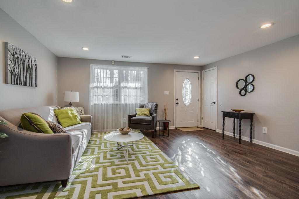 Transitional living room with Greek key patterned area rug.