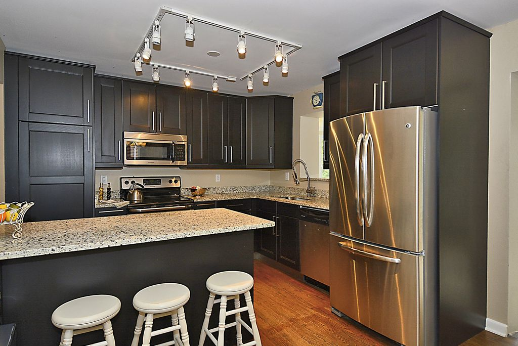 Kitchen With Hardwood Floors Complex Granite In Silver Spring Md Zillow Digs