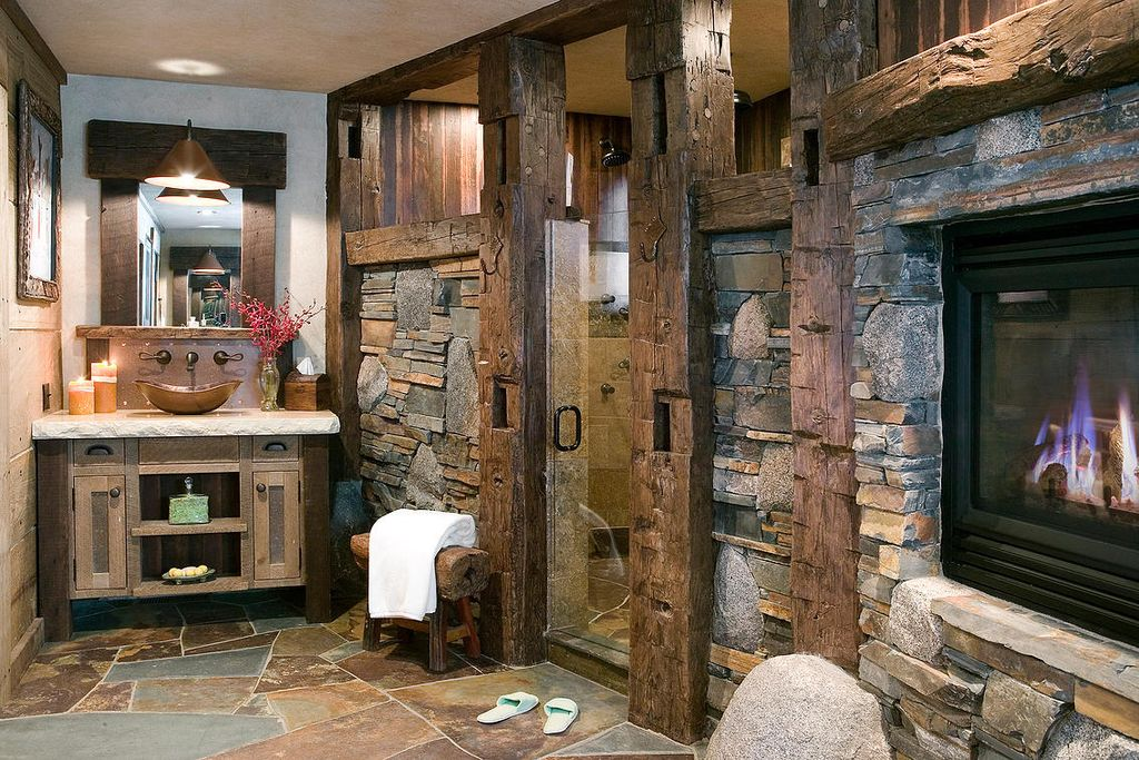 Rustic 3 4 bathroom with european cabinets by high camp for Rustic master bathroom designs