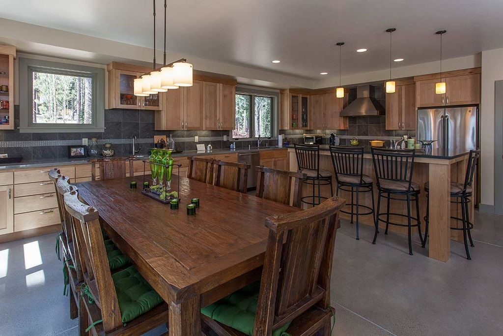 craftsman dining room with high ceiling built in