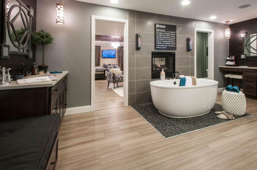Modern Master Bathroom With High Ceiling Pendant Light
