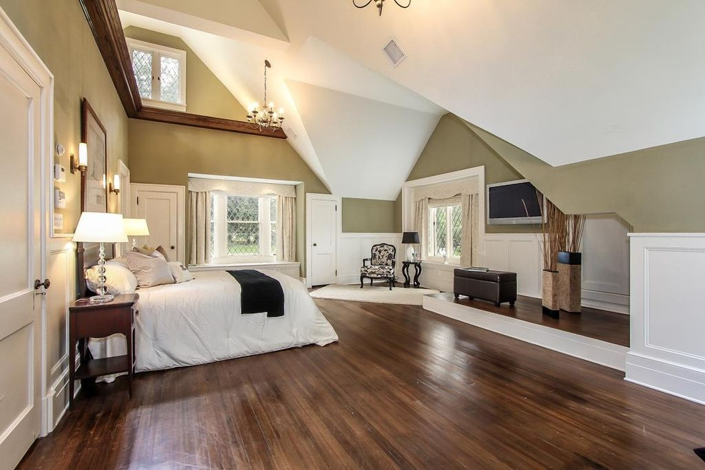 traditional master bedroom with wall sconce by houlihan