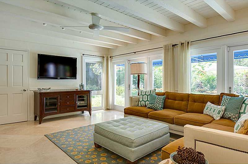 Room with Ceiling fan & Exposed beam in Coral Gables, FL  Zillow Digs