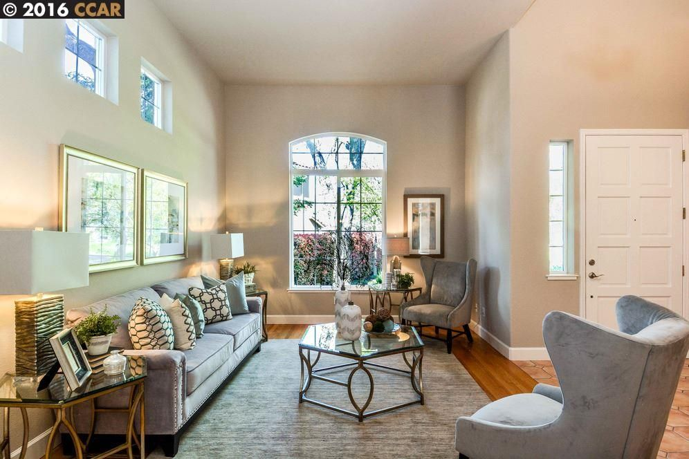 Traditional Living Room Design Ideas picture of breathtaking traditional living room decorating ideas 3lan9 for eye catching home design inspiration Traditional Living Room With High Ceiling Hardwood Floors Carpet