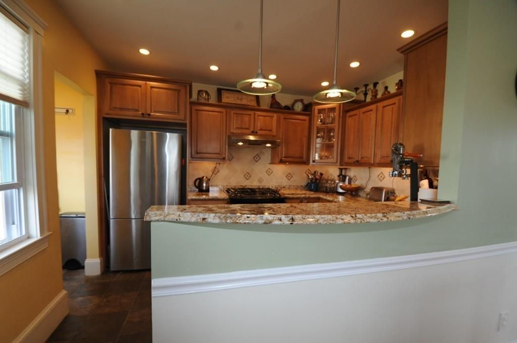 Traditional kitchen with raised panel complex granite in for Kitchen cabinets quincy ma