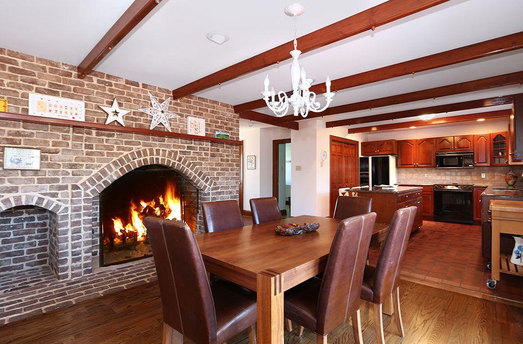 craftsman dining room with pendant light hardwood floors