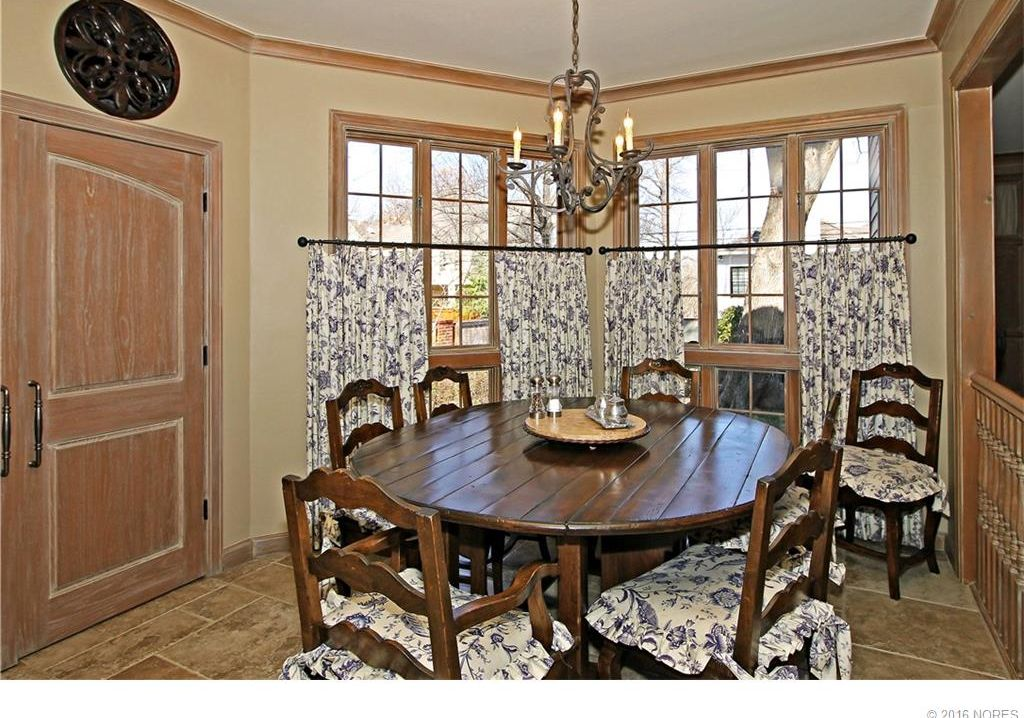 country dining room with pendant light high ceiling in tulsa ok