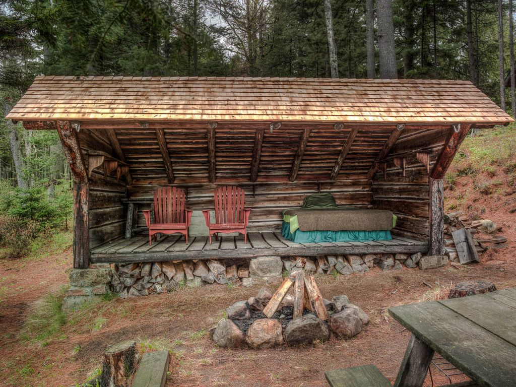 Rustic Landscape And Yard With Wrap Around Porch amp Fire