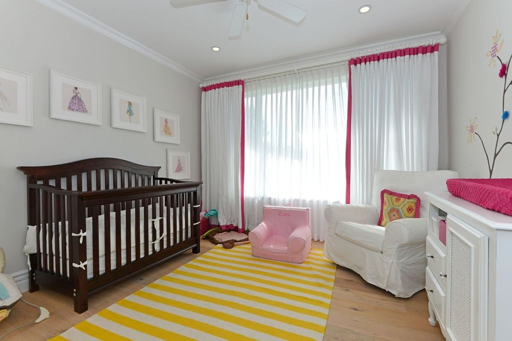 traditional kids bedroom with crown molding ceiling fan carpet high