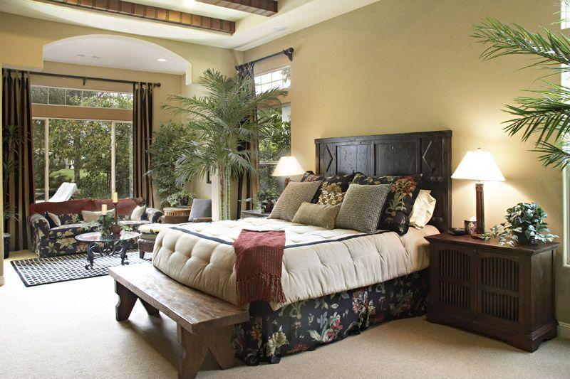 Tropical Master Bedroom With Exposed Beam amp Carpet In La Quinta CA