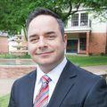 Justen Burnham, Real estate agent in