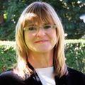 Lori Brauer, Real estate agent in Flanders