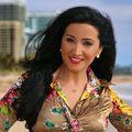 Silvia Olivera, Real estate agent in