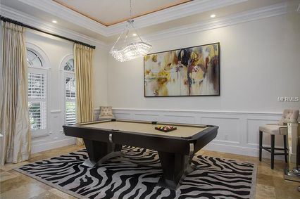 Traditional Game Room with Wainscoting u0026 Crown molding in Tampa