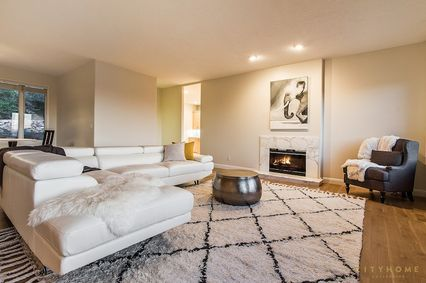 contemporary living room with hardwood floors & carpet in salt