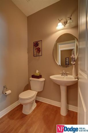 traditional powder room with high ceiling   specialty door