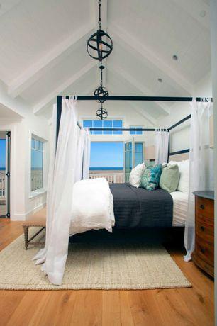 Mediterranean Master Bedroom with Exposed beam, Hardwood floors, Carpet,  Cathedral ceiling, Pendant