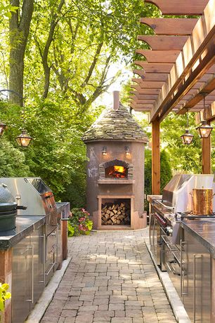 Transitional Patio with Pathway, exterior brick floors, Outdoor kitchen,  Fence, Trellis