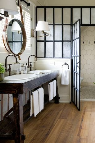 rustic master bathroom with crown molding mid century overarching wall sconce hardwood floors