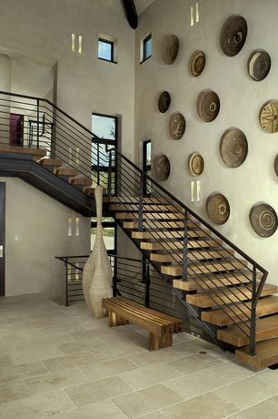 1 tag Contemporary Staircase with High ceiling, Wall sconce, Exposed beam,  Hardwood floors