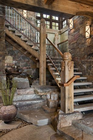 Rustic Staircase With Metal Railing, Slate Floors, Interior Stone Wall,  High Ceiling,