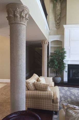 Traditional Living Room With Carpet, Built In Bookshelf, Columns, Metal  Fireplace,