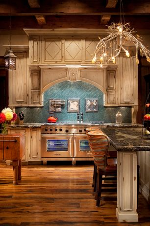 Eclectic Kitchen With Chandelier, Breakfast Bar, Kitchen Island, Kichler    Organique 5 Light