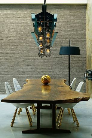 Eclectic Dining Room With Interior Wallpaper Concrete Floors