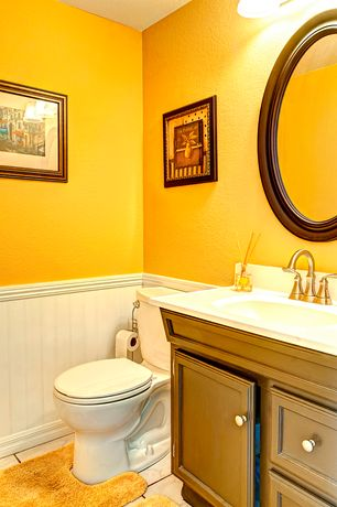 4 Tags Cottage Powder Room With Howard Elliott Nero Oval Mirror, Limestone,  Wainscoting, Complex Marble