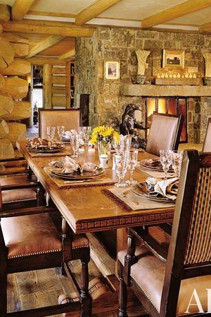 Rustic Dining Room With Stone Fireplace, Exposed Beam, Hardwood Floors