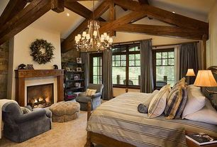 Rustic Master Bedroom With Chandelier By