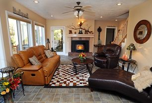 Country Living Room With Metal Fireplace Slate Tile Floors Carpet Ceiling Fan