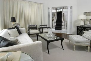 Modern Living Room With High Ceiling Columns Hardwood Floors