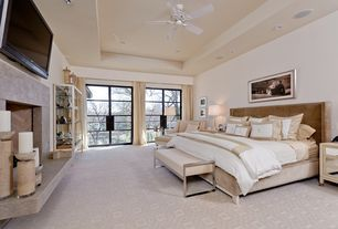 3 tags modern master bedroom with cement fireplace french doors sahara gold marble countertop carpet