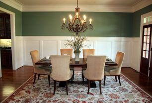 Traditional Dining Room With Hardwood Floors Crown Molding Chandelier Glass Panel Door
