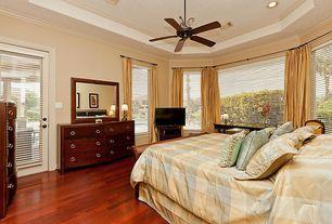traditional guest bedroom with crown molding hardwood floors brazilian cherry hardwood floors french