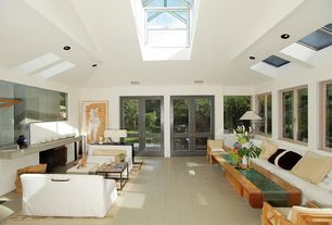 Contemporary Living Room With Skylight Cement Fireplace Limestone Tile Floors French Doors