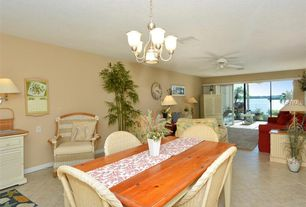 Tropical Dining Room With Carpet, Wall Sconce, High Ceiling, Pendant Light,  Limestone