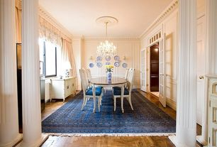 Traditional Dining Room With French Doors, Chandelier, Columns, Hardwood  Floors, Carpet