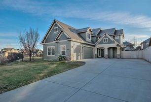 Traditional Exterior Of Home With Exterior Stone Floors, Fence, Gate,  Pathway