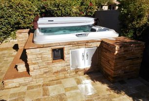 rustic hot tub with fence exterior tile floors