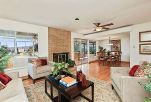 Contemporary Living Room With Interior Brick Ceiling Fan Hardwood Floors Crown Molding