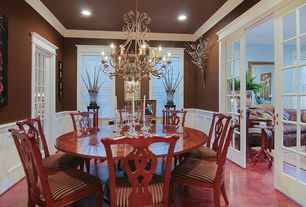 Traditional Dining Room With Crown Molding Laminate Floors Chair Rail French Doors