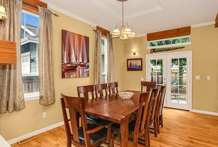 Craftsman Dining Room With Hardwood Floors, Pendant Light, Wall Sconce,  High Ceiling,