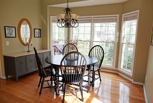 Country Dining Room With Hardwood Floors, Pendant Light, High Ceiling