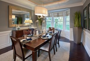 transitional dining room with wainscoting crown molding hardwood floors chandelier high ceiling